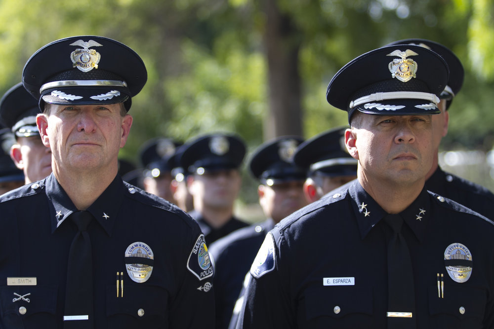 Commander E. Smith (left) and Deputy Chief E. Esparza(right) prepare and lead Santa Ana police officers to march in formation to commemorate fallen Ventura County Sheriff Sgt. Ron Helus on Thursday, Nov. 15, 2018, in Westlake Village, California. Law enforcement agencies across the country join together to memorialize Sgt. Helus death during the Borderline Bar & Grill shooting on Wednesday, Nov. 7, 2018. (Photo by Andrew Narváez)