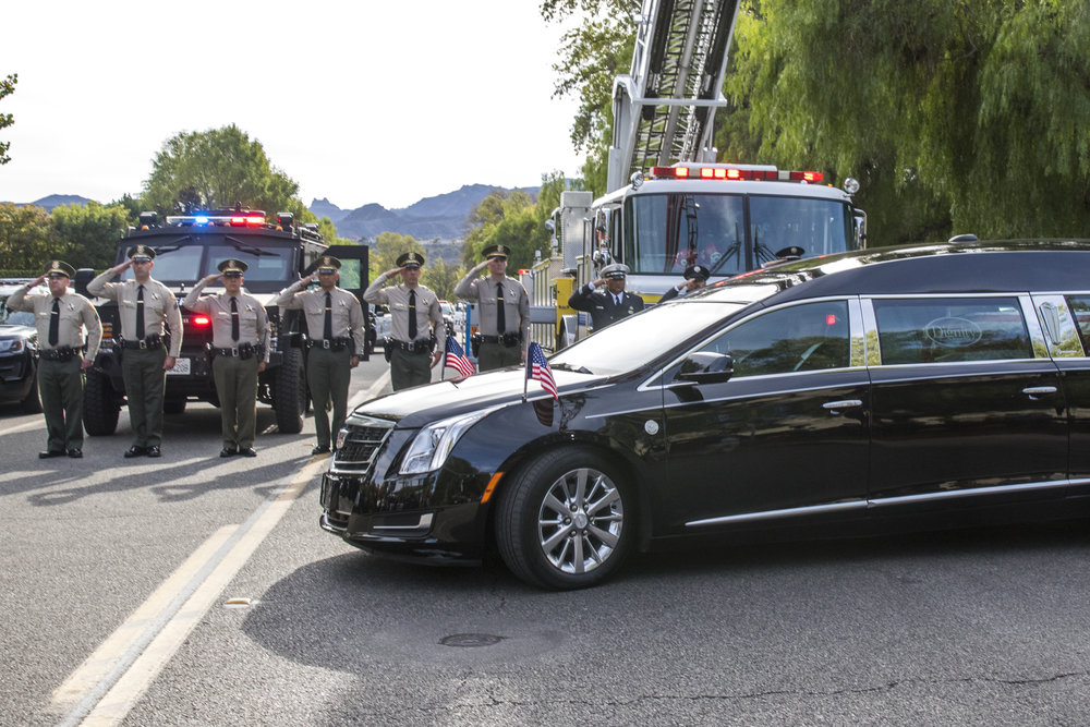 A hearse containg the deceased Sergeant Ron Helus leaves the Calvary Community Church while receiving a salute from members of the Los Angeles Sheriff Department on November 15, 2018 in Westlake Village, California. Helus was killed at the Borderline Grill Shooting on November 7, 2018. (Zane Meyer-Thornton/Corsair Photo)
