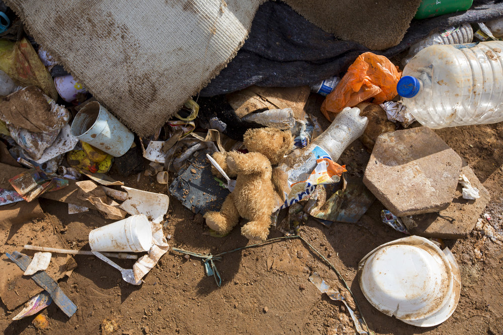 A stuffed animal is left behind, alongside other personal items, at the Benito Juarez Sports Complex on December 1, 2018 in the Zona Norte neighborhood of Tijuana, Mexico. Rain over the past couple days has turned the shelter into an unsanitary flooded space resulting in the need to evacuate the migrants to a new location. Piles of clothes, sleeping bags, blankets, and other personal items now liter the field after many migrants were forced by the conditions to evacuate without the option of packing up their belongings. Photo By: Jose Lopez / Corsair Contributor