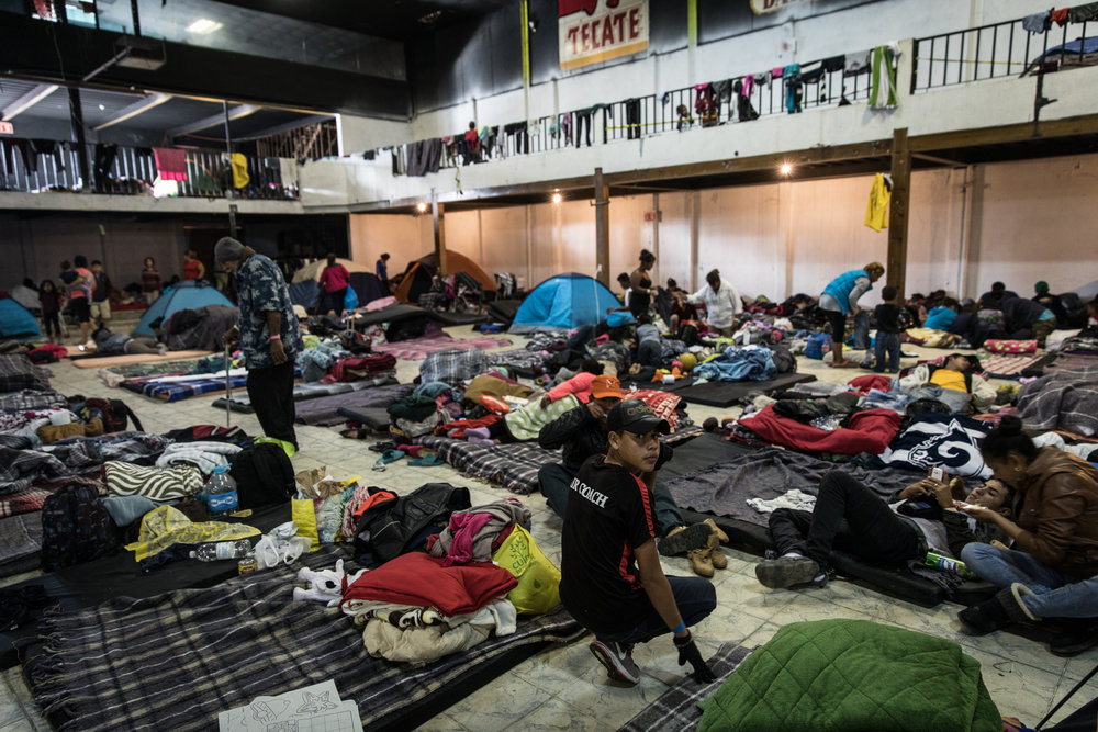 Refugees rebuild their tents and settle in at Barretal in the Desarollo Urbanojito Matoros district of Tijuana, Mexico on Dec 1, 2018. Asylum seekers previously housed at Benito Juarez have been moved on November 30, 2018 due to flooding from rainfall. The new camp location, Barretal, is a former concert venue that has been repurposed into an impromptu shelter. Photo By: Zin Chiang / Corsair Contributor