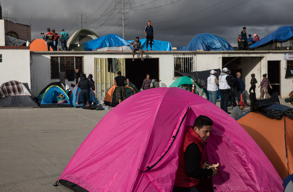Displaced Hondurans rebuild their tents and settle in at El Barretal in Tijuana, Mexico, Saturday, Dec. 1, 2018. Asylum seekers previously housed at Benito Juarez sports complex have been moved on Friday, Nov. 30, 2018, due to flooding from rainfall. The new camp location, El Barretal, is a former concert venue that has been repurposed into an impromptu shelter. Photo By: Zin Chiang / Corsair Contributor
