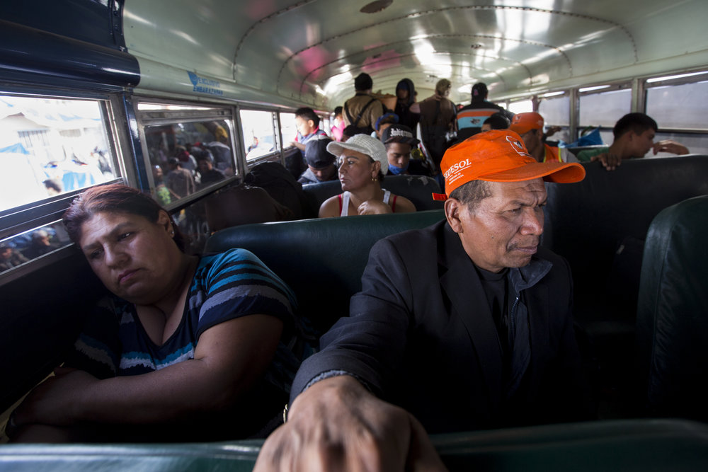 Central American migrants, mostly from Honduras, board a bus that will evacuate them from the flooded Benito Juarez sports complex to the new shelter situated at El Barretal in Tijuana, Mexico, Saturday, Dec. 1, 2018. The rain hitting this area in the last few days has turned the shelter into an unlivable muddy space raising health concerns resulting in the need to quickly find a sanitary new space for the migrants. There are still an estimated 300 or more migrants who have remained camped out on Avenida 5 de Mayo, in front of the sports complex, due to concerns that the new location is too far removed from where they are applying for asylum. Additionally, there is a concern about whether they will be free to leave the shelter. Photo By: Jose Lopez / Corsair Contributor