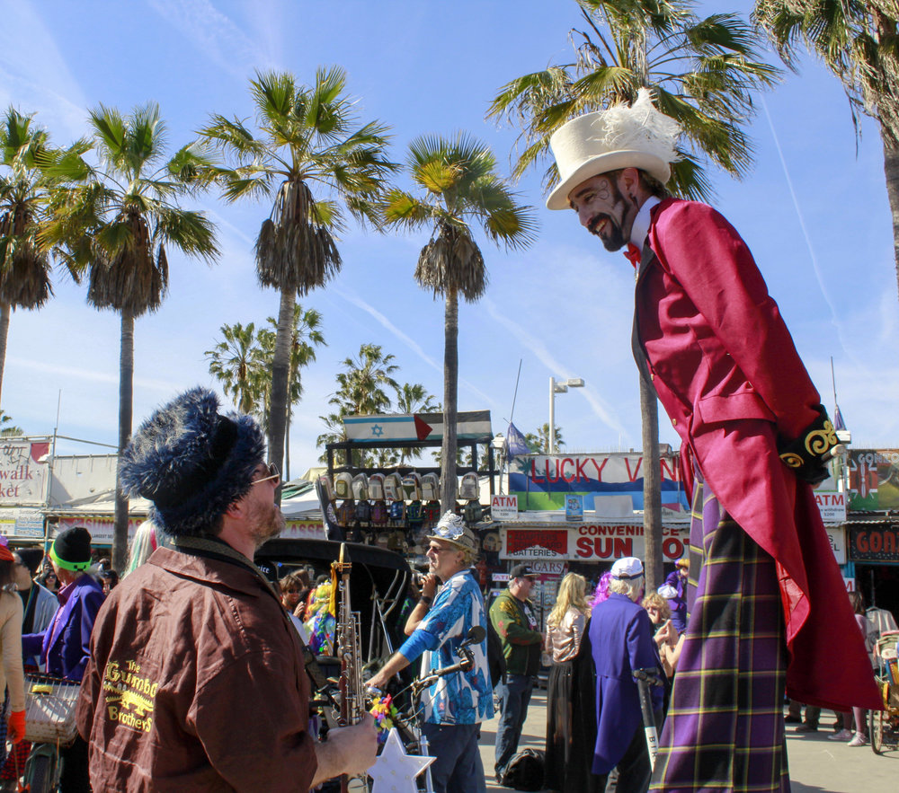 Jon McBride (left) and Antonio G-R (right) greet each other at the end of the 17th annual Venice Beach Mardi Gras parade on Feb 23, 2019 in Los Angeles, California. Jon and Antonio have been attending since the 2nd Parade. Photo by Danica Creahan.