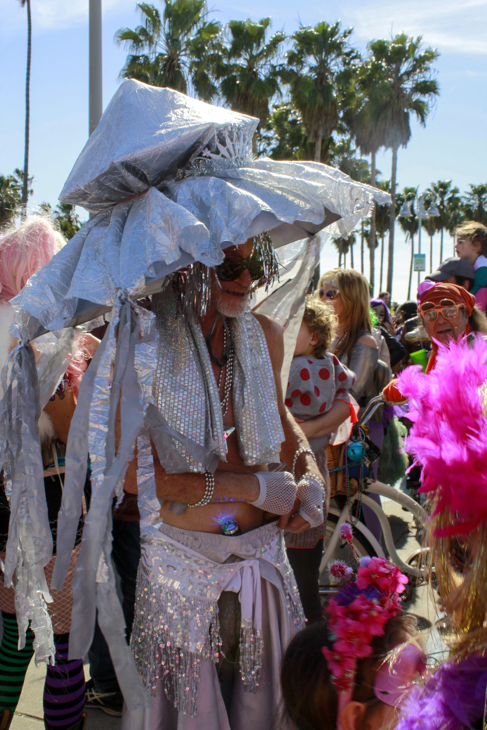 Mark Snyder watching the crowd rush around him at the end of the Venice Beach Mardi Gras parade on Feb 23, 2019 in Los Angeles, California. Photo by Danica Creahan.