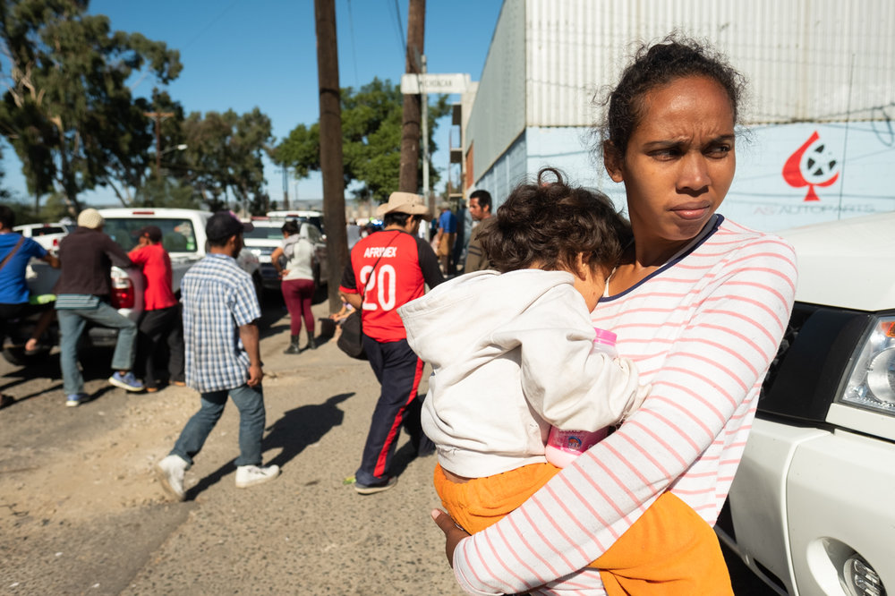 A migrant family arrives at the Benito Juarez Sports Complex in Tijuana, Mexico on November 16, 2018. (Photo by Jayrol San Jose)