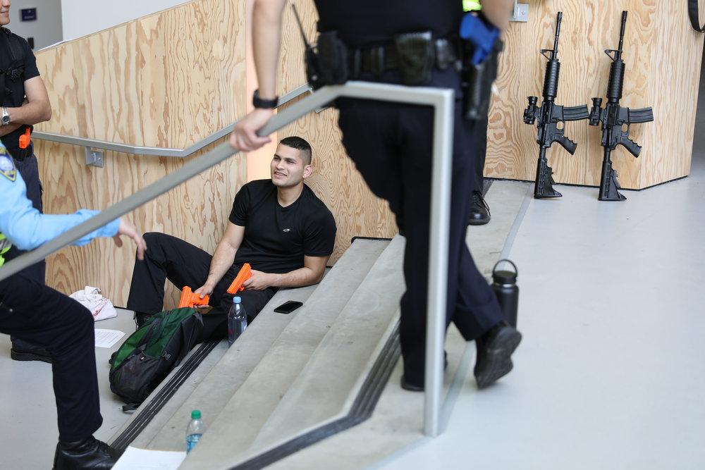 The SM Police prepare for a drill with the mock terrorist