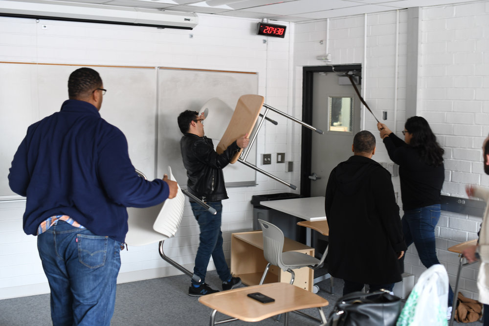 Volunteer Santa Monica College Faculty secure the doorway of a classroom during the Active Shooter Drill, Friday, March 1, 2019, on the second story of D Building at the SMC Center for Media and Design, Santa Monica, Calif.