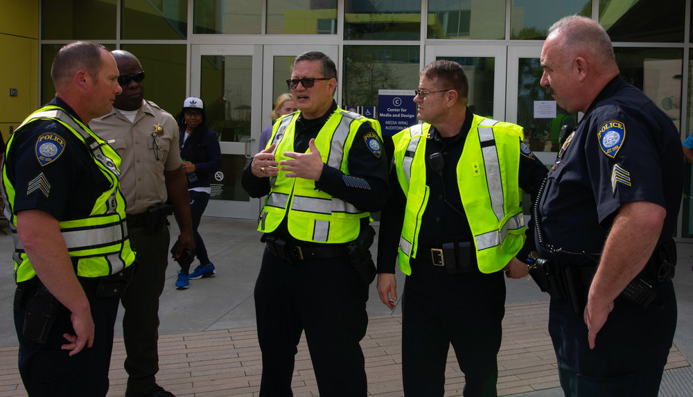 SMCPD Chief Adams, flanked by other SMCPD SGTs including SGT. Romano and a Los Angeles County Sheriff Deputy, during briefing just prior to the start of an active shooter training simulation at CMD on Friday, March 1st 2019.