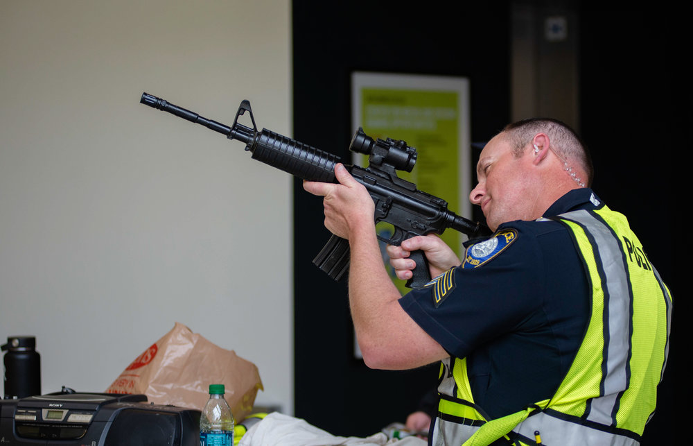 A SMCPD SGT. inspecting a dummy AR15 just before that start of an active shooter training simulation at CMD on Friday, March 1st 2019.