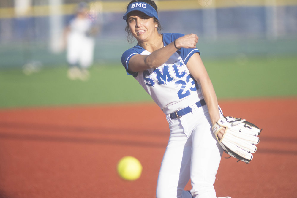 Taylor Liebesman (#23) throws a fast moving ball on Thursday afternoon, March 7, 2019, as the Santa Monica College Corsair's softball team defeated the Questa College Cougars. (Victor Noerdlinger/Corsair Staff)