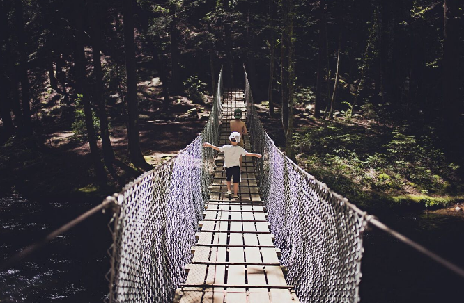 Jenny's two boys on the swing bridge on the trail to the base of Foster Falls