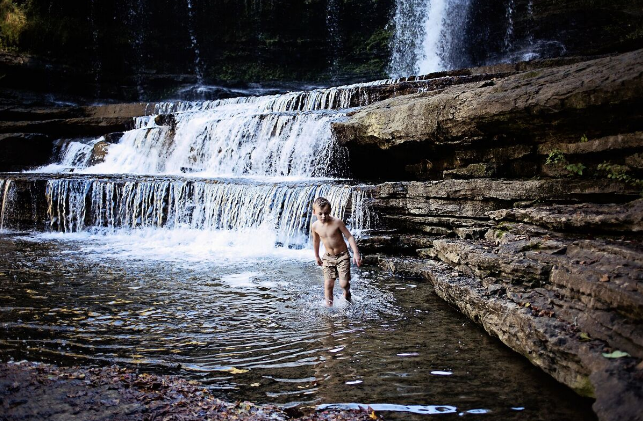 Jenny's son in the water at Cummins Falls, TN