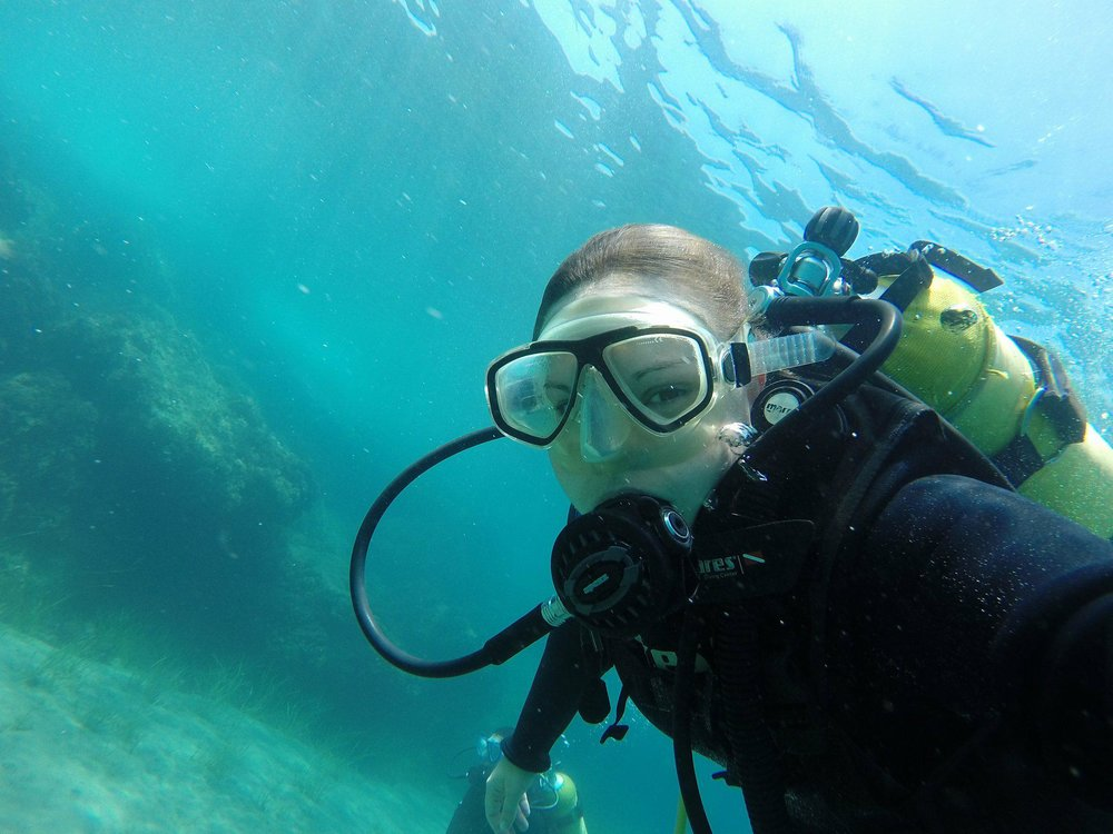 Fun fact, Elamon is also SCUBA Certified. She has focused a lot of her efforts recently on protecting the environment on land, but also loves and strives to protect our oceans. Every now and again she gets an opportunity she goes SCUBA diving. Pictured here is her diving off the coast of Limassol, Cyprus. An island in the middle of the Mediterranean Sea below Turkey.
