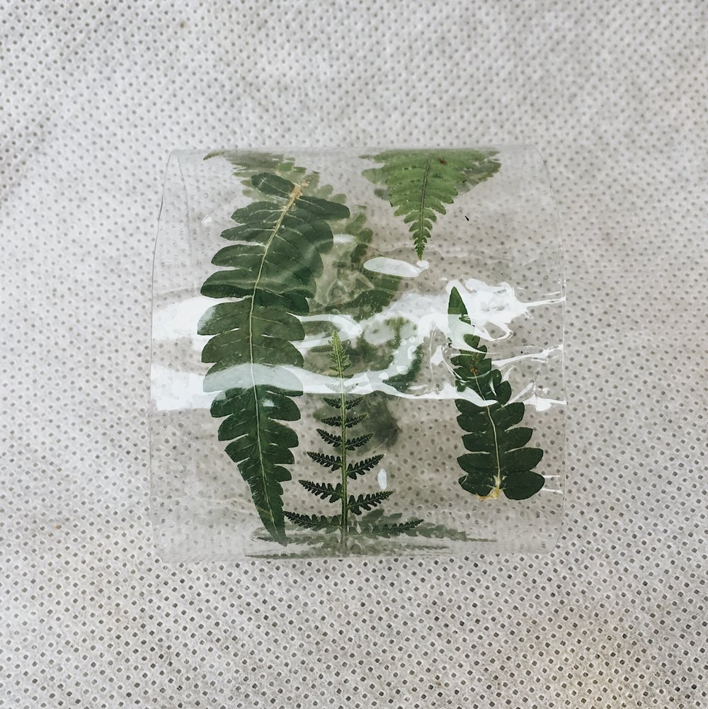 Fern filled vinyl cuff.