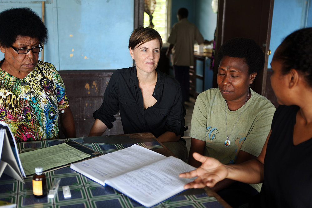 Nursing Officer Mother Mary Salib (far left), Dr Leanne Robinson, Community Health Worker Anastasia Kali, and Dr Maria Ome-Kaius (far right) discuss their malaria research work at St. Martin De Porres Health Centre in Mugil, Papua New Guinea.