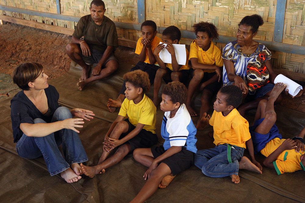 Dr Leanne Robinson talks to students and parents about on an ongoing malaria study at Houdini village school near Madang, Papua New Guinea.