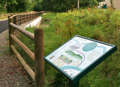 Walkers on this public trail in Redmond, WA, can learn about the stormwater wetland that cleans runoff from the parking lot of the large shopping center adjacent.