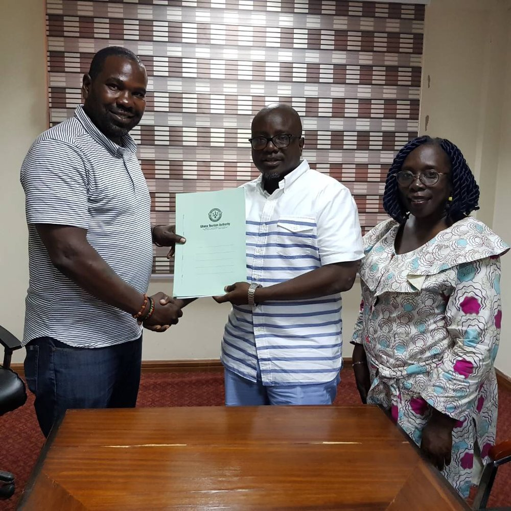 L to R: Diallo Sumbry, President of The Adinkra Group, Akwasi Agyeman, CEO Ghana Tourism Authority and Felicia Aniagyei, PR Manager for Ghana Tourism Authority after signing a partnership agreement between The Adinkra Group and Ghana Tourism Authority.