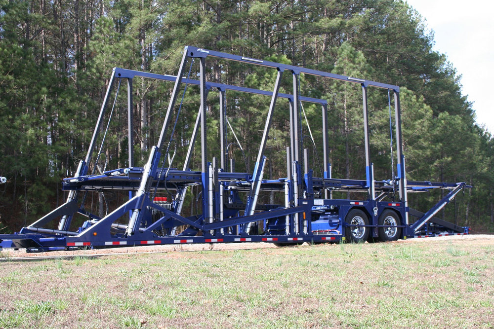 4000 GS - Our high-rail, stack-style maximum capacity loader. Carries up to 11 vehicles: 7 cars on the trailer + 3 or 4 cars on head ramp.View model details