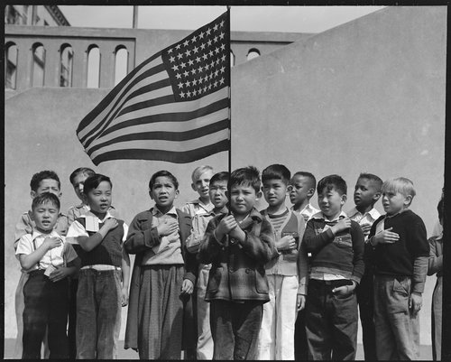 San Francisco, California. Flag of allegiance pledge at Raphael Weill Public School, Geary and Buchanan Streets. Children in Families of Japanese ancestry were evacuated with their parents and will be housed for the duration in War Relocation Authority centers where facilities will be provided for them to continue their education. War Relocation Authority, National Archives.