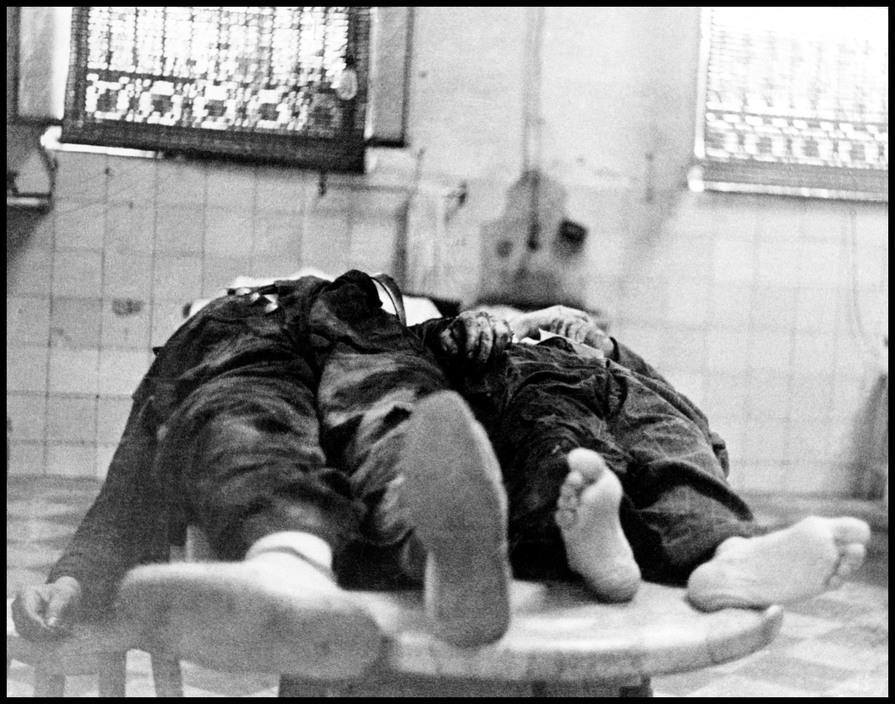Air raid victims in the morgue.  May, 1937. Valencia, Spain.