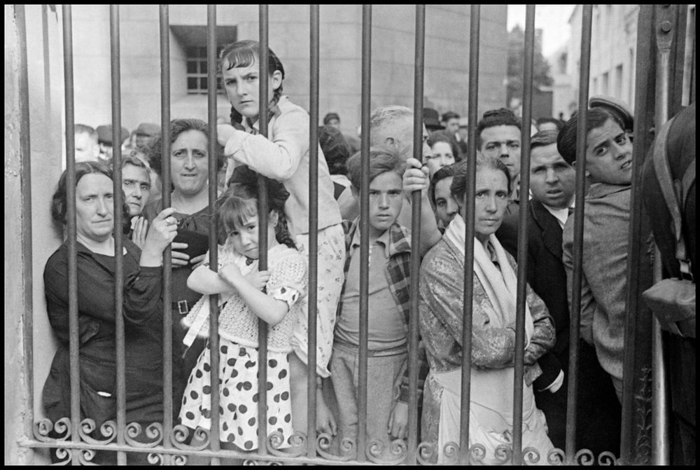 Crowd outside morgue after air raid.  May, 1937. Valencia, Spain.