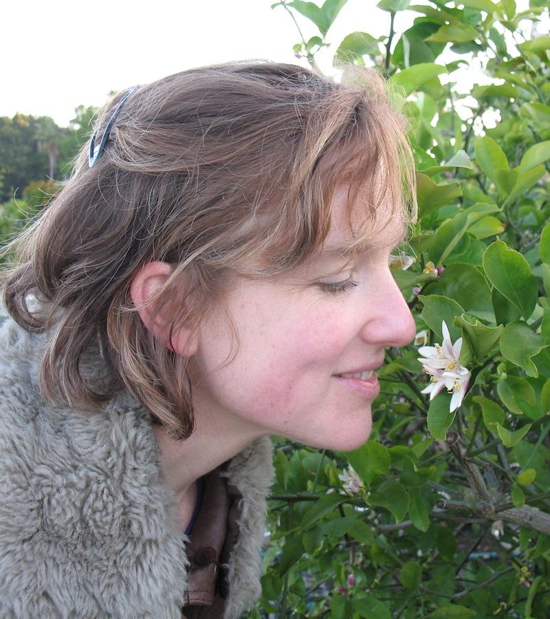 Eliza Douglas smalling a flower