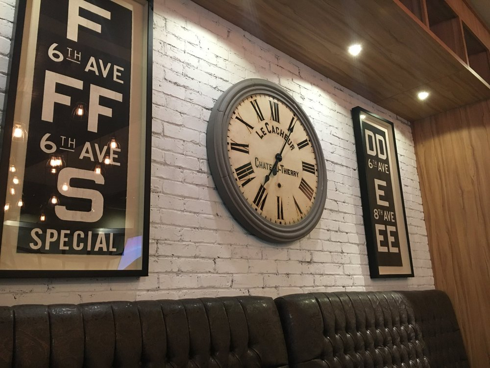 Who doesn't love a giant wall clock and some exposed brick?