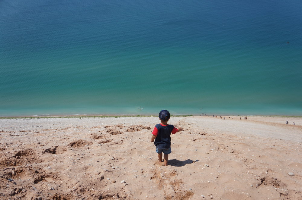 Reid staring down at Lake Michigan from above. Sleeping Bear Dunes, Michigan.