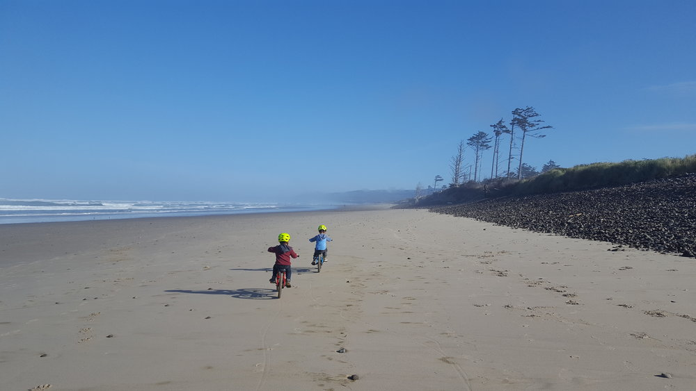 Cape Lookout State Park, Oregon.  The most beautiful stretch of sand, no highway nearby, fun beach towns to the north, and well, you could ride your bikes on it.