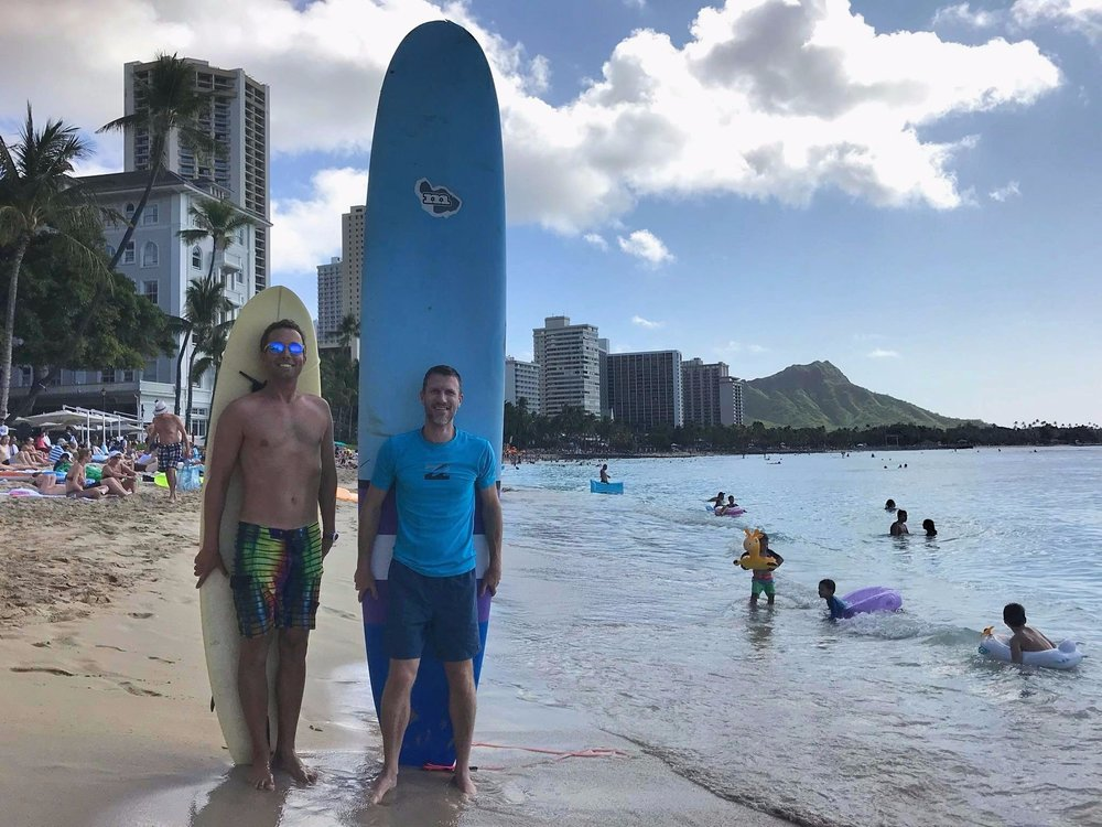 Chip & Brian heading out for a surf sesh on Waikiki Beach. Honey, did somebody shrink your surfboard?