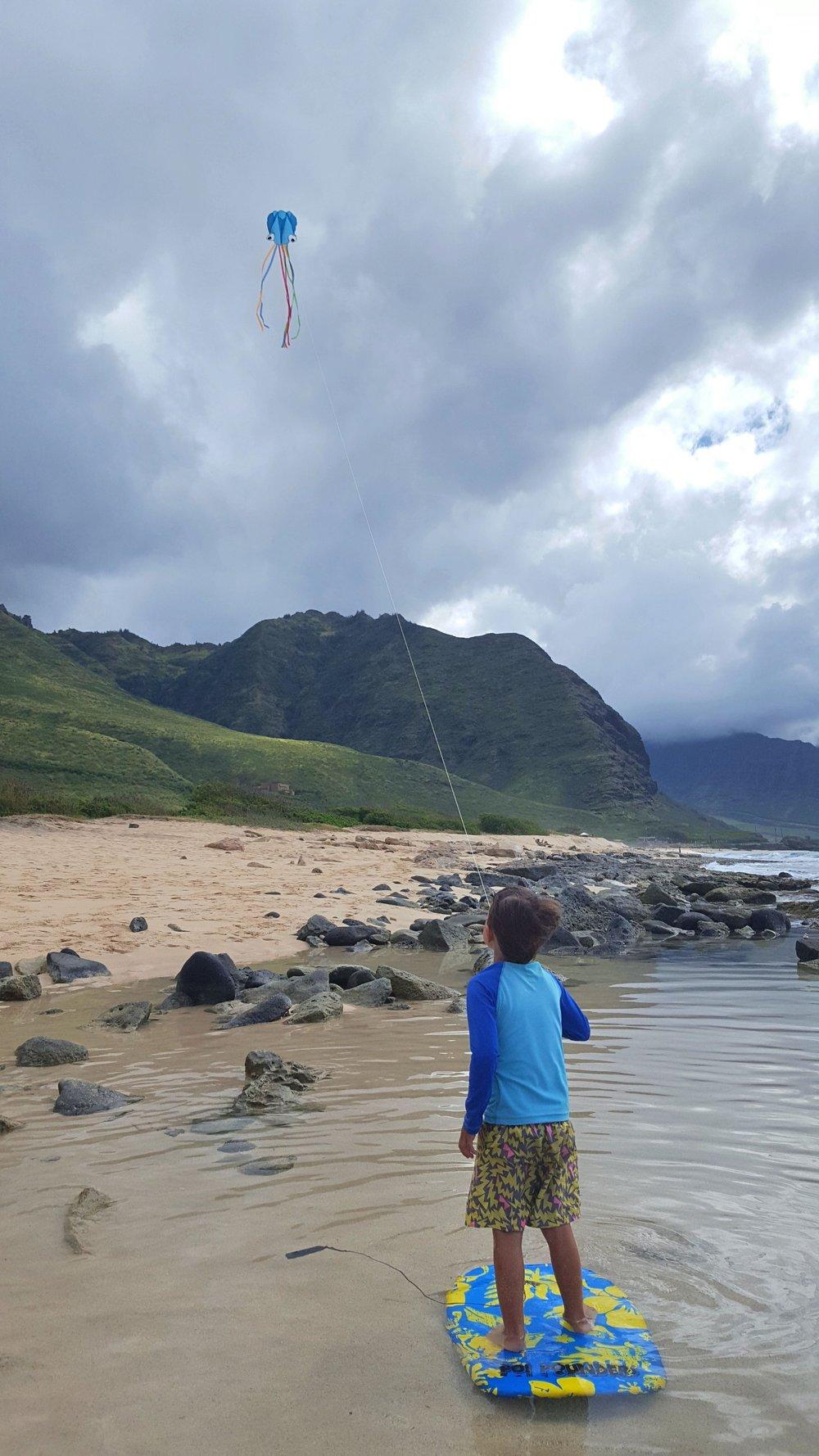"Bennett's idea of the day: ""Hey mom, look! I'm kitesurfing like dad!!!!"""
