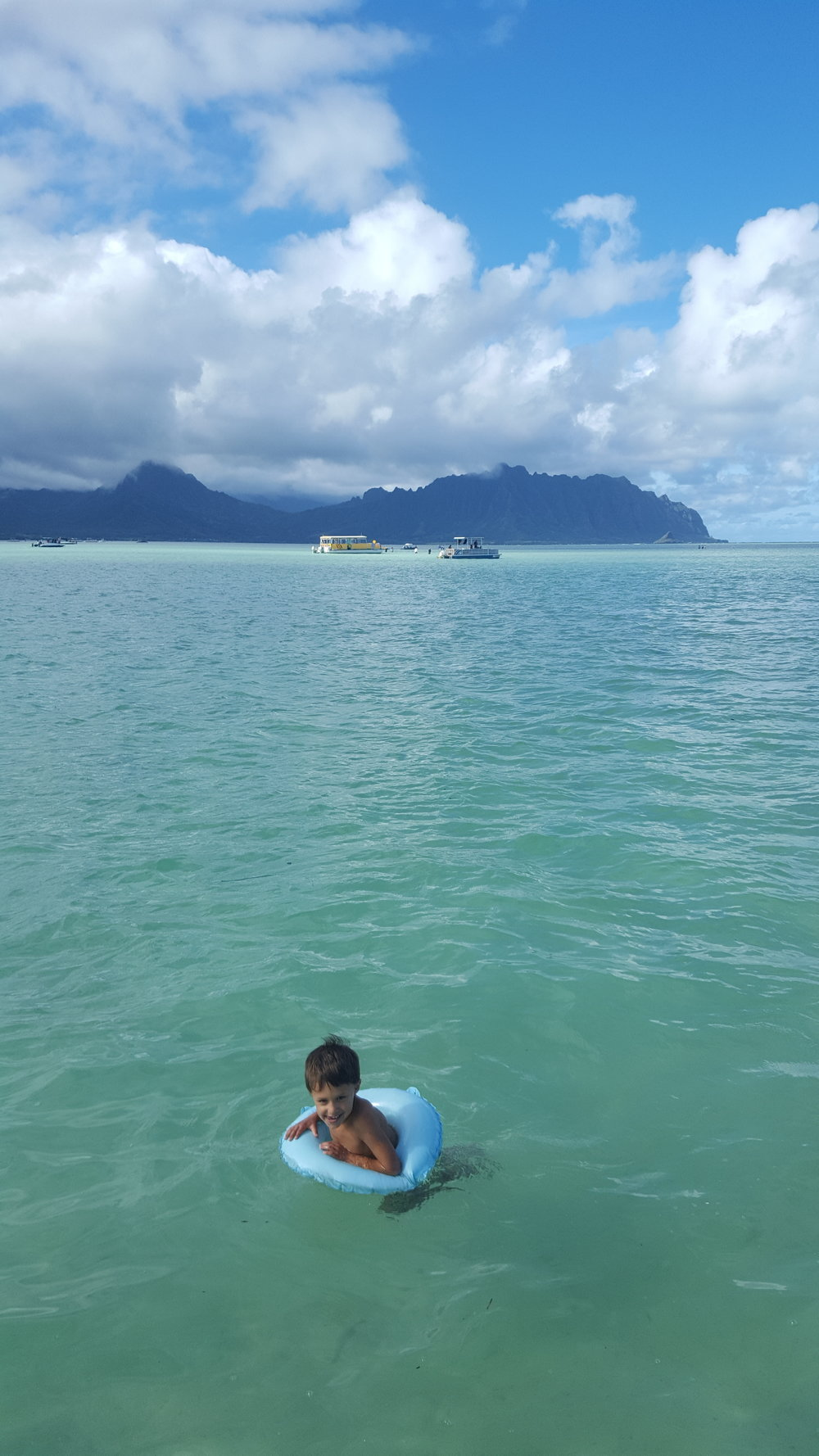 A boat ride in Kaneohe Bay with friends - Bennett taking a quick dip.