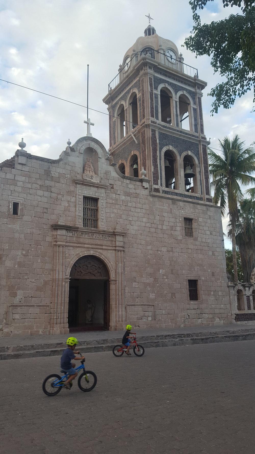 Biking past Misión de Nuestra Señora de Loreto Conchó