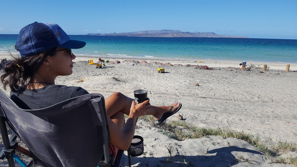 Summing up Baja life in one photo…sipping vino, watching jibs with trucks, and listening to the gentle crash of ocean waves.