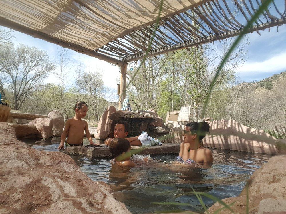 Nestled under the gazebo hot springs pool.