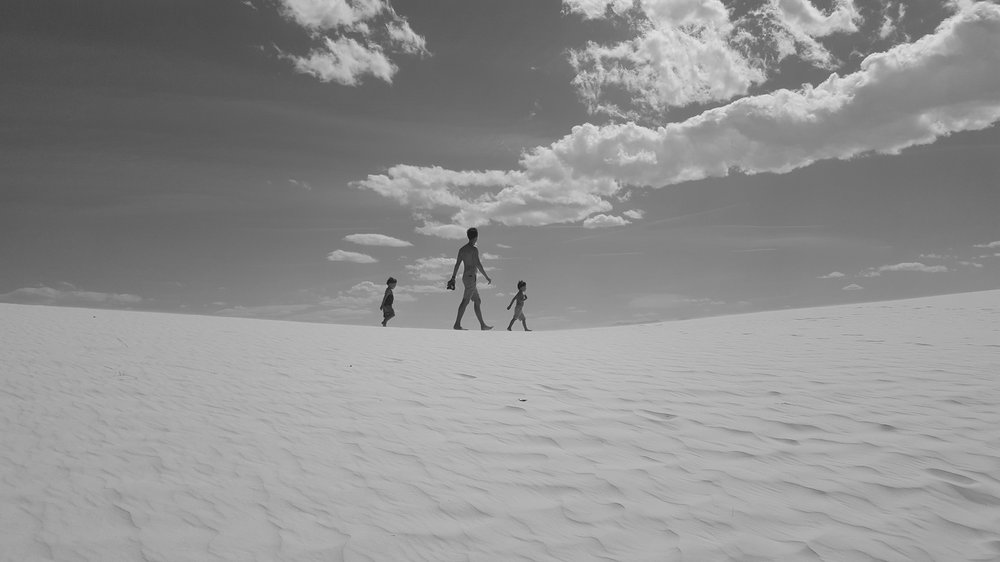 My boys summiting a dune at White Sand Dunes National Monument.