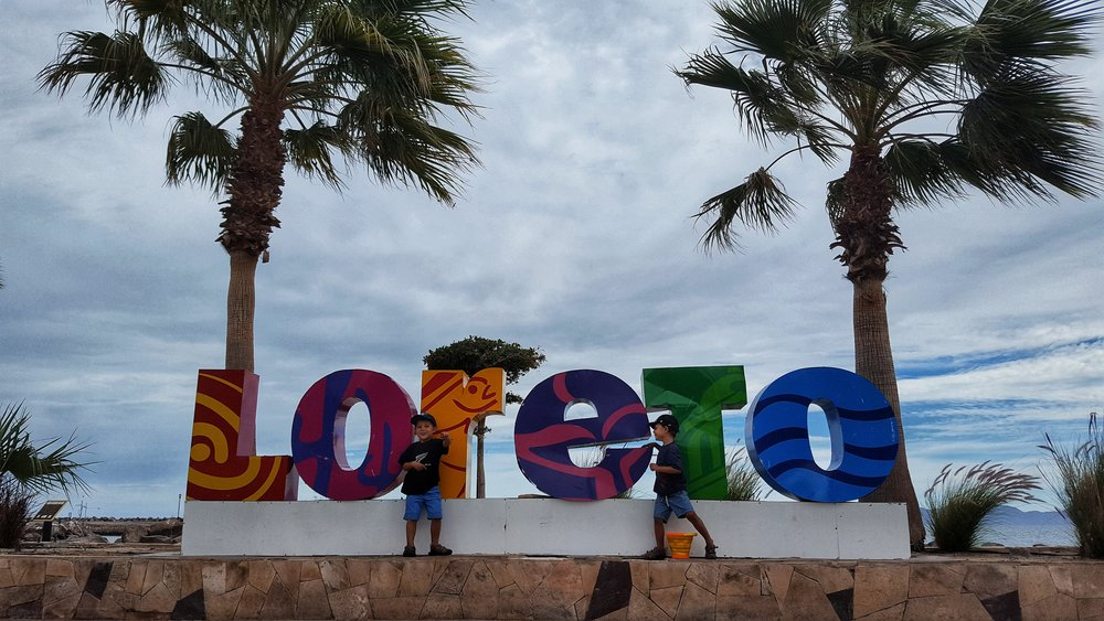 All the larger towns and cities in Baja have these adorable welcome signs - Here we are exploring near the sea in Loreto, Baja.