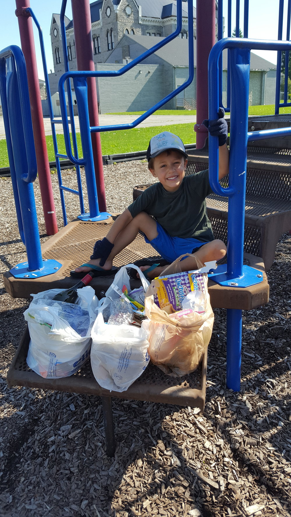 RAK: Sandusky, Ohio - Bennett wanted to complete his own park clean up so we found gloves, bags, and went to it.