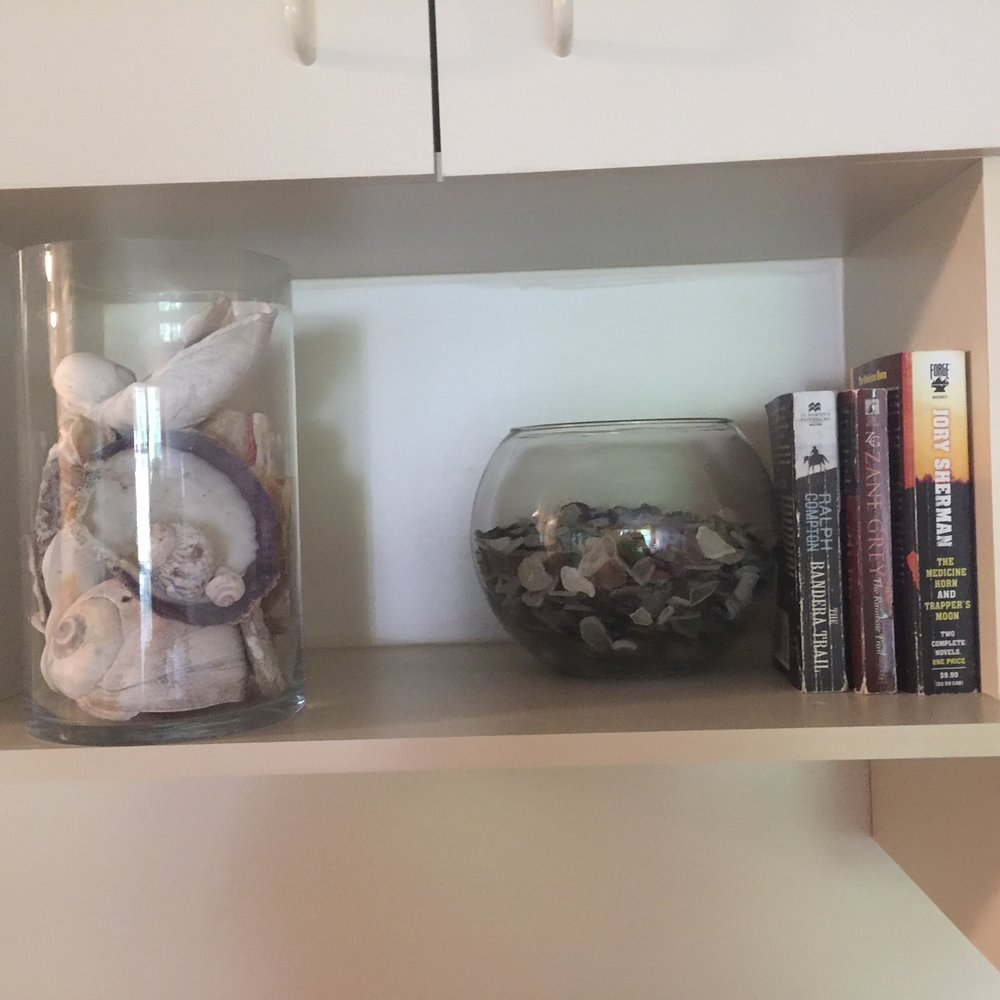 Seashells glass and books .JPG
