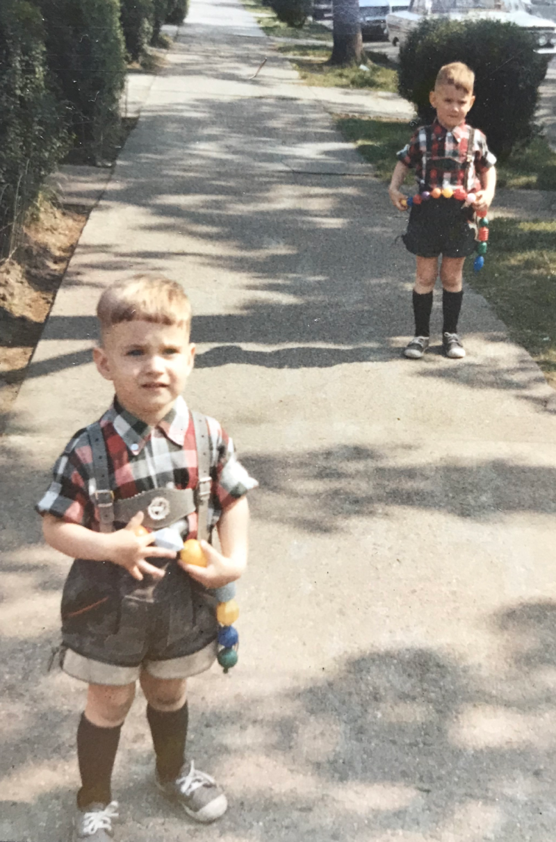 "Marty and his brother Peter running around the streets of Queens, NY in their Lederhosen.  This is the inspiration of today's ""company uniform""."