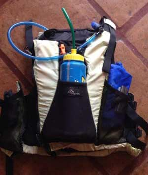 Buoyancy aid with adapted water bottle to allow drinking whilst paddling