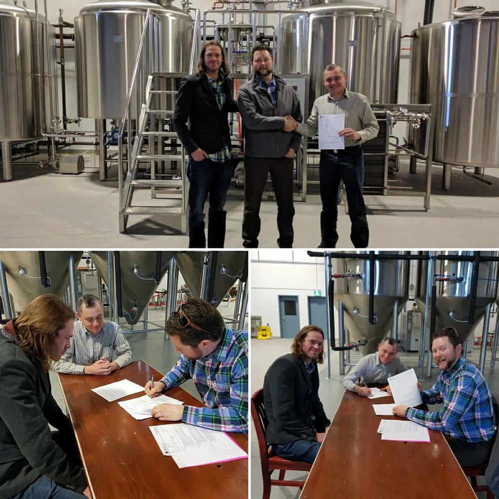 Vlad and the team getting their license to start brewing.