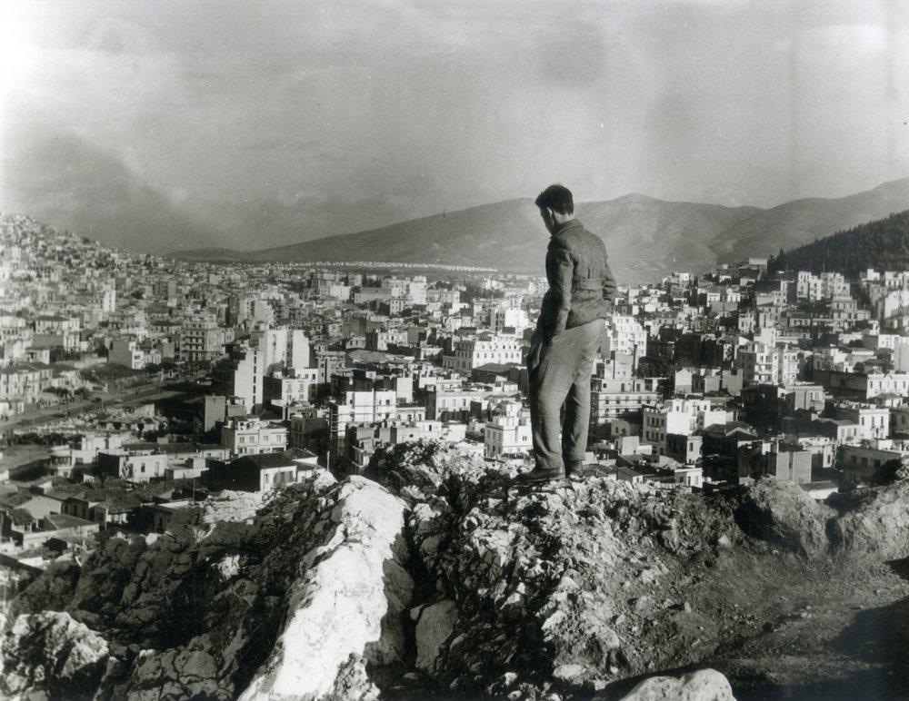 Man contemplating the expansion of the twentieth-century city, Athens, 1957. © Benaki Museum, Costas Megalokonomou Archives