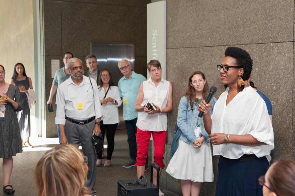 Luckett delivering opening remarks at the  20/20  exhibition Gallery Conversations event in partnership with By Any Means ,  August 3, 2017 .  Courtesy of the Carnegie Museum of Art.