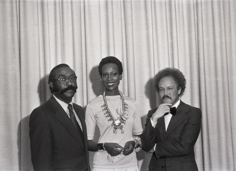 Naomi Sims with Dr. Herman Reed and Alfred Morris at a NEED annual dinner, Pittsburgh, 1965. Photo by Charles Teenie Harris, courtesy of Historic Pittsburgh.