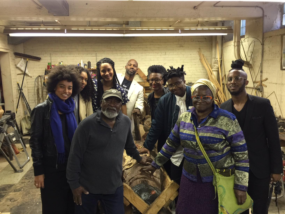 Thaddeus Mosley By Any Means studio visit, April 23, 2016. Left to right: Rujeko Hockley, Taylor Renee Aldridge, Thaddeus Mosley, Jessica Lynne, Nathaniel Donnett, Kilolo Luckett, Tiona Nekkia McClodden, Charlotte Ka, and Ikechukwu Casmir. Courtesy of Kilolo Luckett.