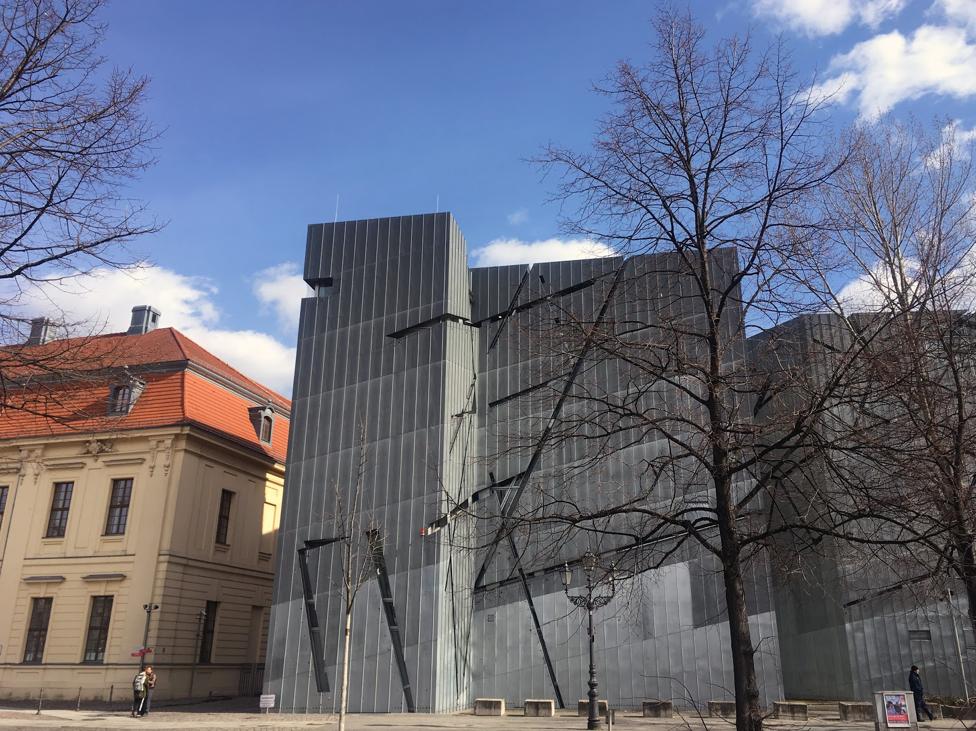 Daniel Libeskind's Jewish Museum, Berlin, includes a Deconstructivist extension that connects underground to the entrance in the original Prussian Court of Justice.