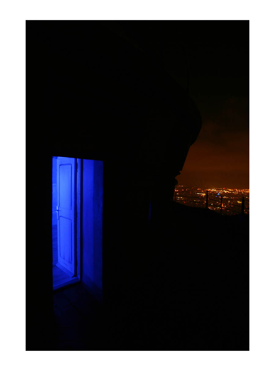 Blue Light  (Barcelona, Spain, 2012) by Johnny Green (43 x 33cm)  Price: £250   Size: 16.9 H x 13 W x 1.2 in   This is the 1st of 12 Limited Edition C-type Lambda prints, encased in a beautiful gloss white ayous wood frame. The matt photograph is signed & dated en verso by the artist and has an elegant off white mount also.