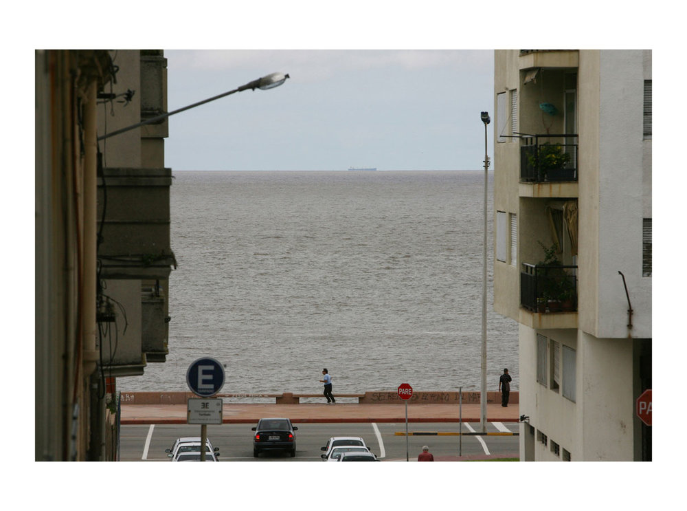 High Tide  (Montevideo, Uruguay, 2010) by Johnny Green (33 x 43cm)  Price: £200   Size: 13 H x 16.9 W x 1.7 in   This is the 1st of 21 Limited Edition C-type Lambda prints, encased in a beautiful, black wooden frame. The matt photograph has an elegant off white mount which is signed and numbered by the artist.